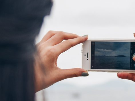 woman filming video with her smartphone